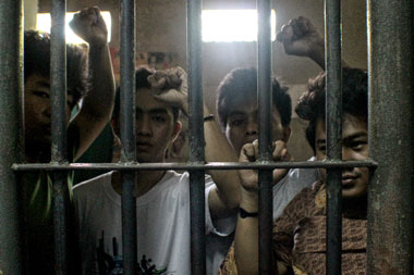 LE JARDIN 4. Shown in this picture (from left) are Johnny Urbina, Joselito Lagon Jr., Wyrlo Enero and Michael Lim, four youth activists who were arrested by the police during last Friday's demolition attempt in Purok 13, Bugac, Maa. They are now detained at the Davao City Police Office in Camp Domingo Leonor. (davaotoday.com photo by Ace Morandante)