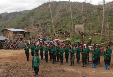 FORMATION. Members of the New People's Army gather in a formation Wednesday during the 44th founding anniversary celebration of the Communist Party of the Philippines somewhere in Compostela Valley province. They sang the Socialist International's official anthem, Internationale, in Filipino. At the backdrop are mountains, livelihood and houses destroyed by typhoon Pablo. (davaotoday.com photo by Ace R. Morandante)