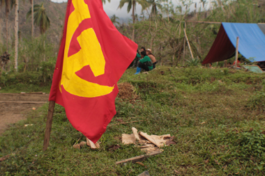 RED FLAG. The flag of the Communist Party of the Philippines (CPP) waves in the wind somewhere in the province of Compostela Valley. The CPP celebrated its 44th founding anniversary Wednesday. (davaotoday.com photo by Ace R. Morandante)