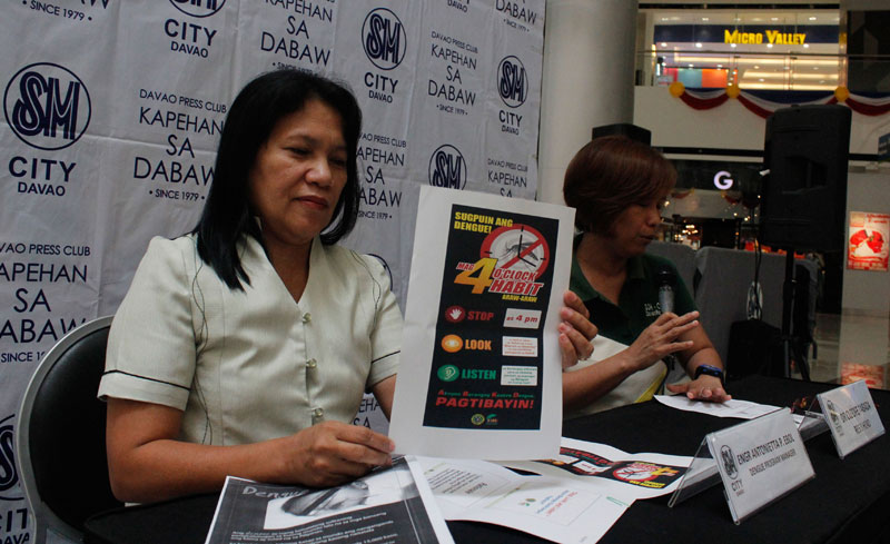 ANTI-DENGUE CAMPAIGN.  Engineer Antonietta Ebol (left), Dengue Program manager of the Department of Health, says they are reviving the 4 o'clock habit both in public schools and government offices during the Kapehan sa SM, Monday in Davao City.  The campaign which heightens during the rainy season involves class and work stoppage at 4 PM to look for possible breeding sites of dengue-carrying mosquitos and destroying these by cleaning up.  (davaotoday.com photo by Medel V. Hernani)