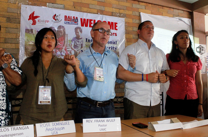 Pablo survivors link hands with Filipino-Americans, Americans and Latin Americans in their call for transparency and delivery of relief and end of military operations in Pablo-affected areas; the foreigners went to Compostela and New Bataan over the weekend for a humanitarian and fact-finding mission. (davaotoday.com photo by Medel Hernani)